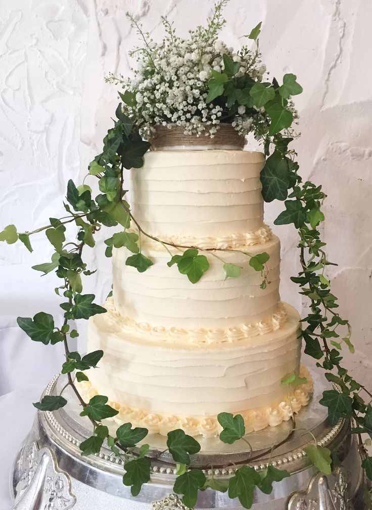 Beautiful delicate gypsophilia and trailing ivy decorate this simple rustic soft iced cake