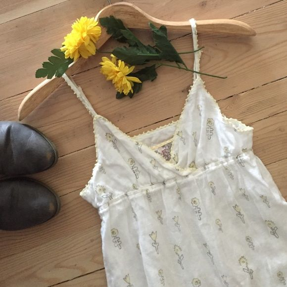 1 HR SALE HP Free People Dress Sweet white dress with yellow flowers and crocheted trim.  Features adjustable straps and is lined.  55% linen and 45% cotton.  In excellent condition. Free People Dresses