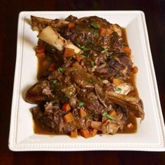 Slow-cooker braised lamb shanks from Scarpetta Dolcetto. http://scarpettadolcetto.wordpress.com/2011/02/26/braised-lamb-shanks/