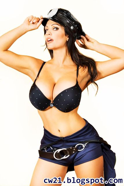 Share: Denise Milani Busty Cop 9
