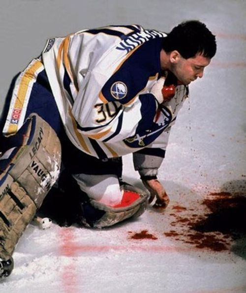 Clint Malarchuk mere moments after having his jugular vein severed during a game on March 22, 1989. The wound was closed after 300 stitches and he avoided becoming the third NHL player to die from an in-game injury. Four days later he was playing in practice, he wanted to play in games too but they made him wait 10 days