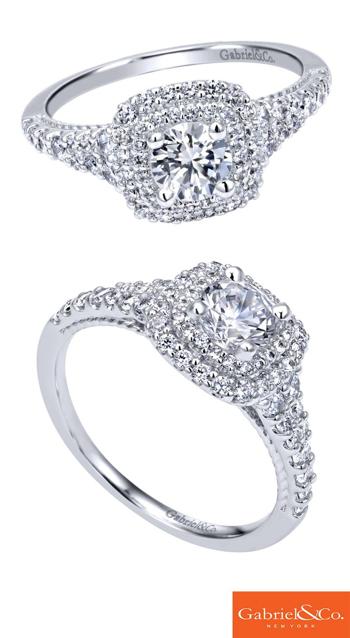 A stunning 14k White Gold Diamond Halo Engagement Ring by Gabriel & Co. that will catch anyone's attention! This unique statement is perfect for the woman of your dreams that would love a piece filled with diamonds and details. Find your perfect engagement ring with Gabriel & Co.