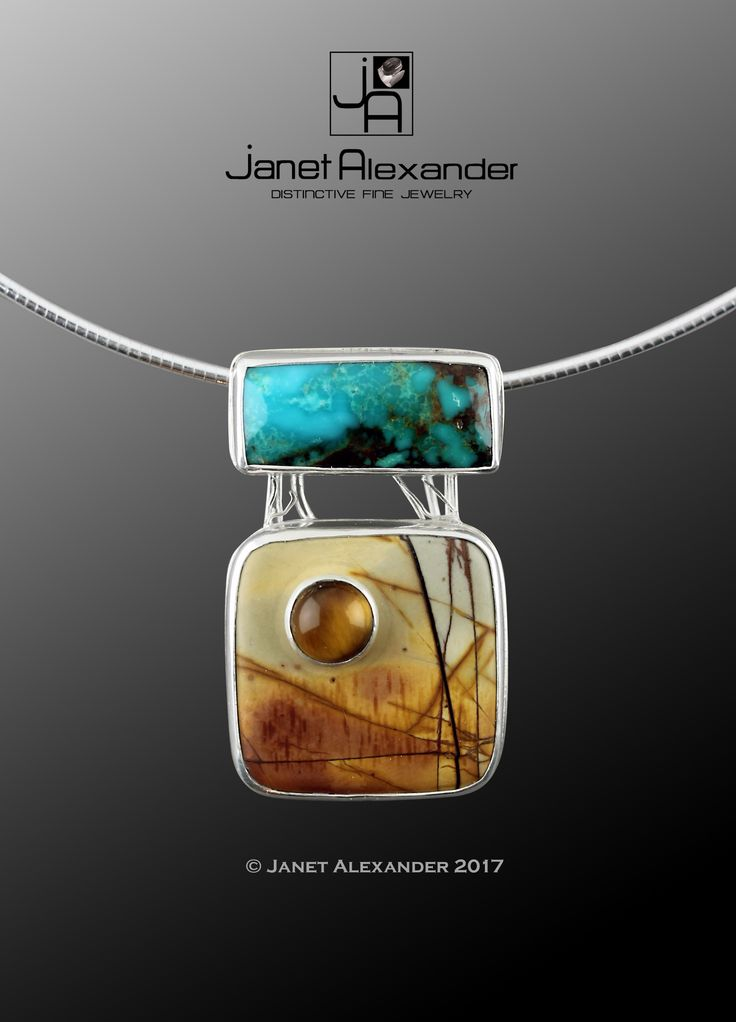 Fall Mountains with Blue Sky  Made in Argentium Sterling Silver. The top stone is a 19mm x 10mm Turquoise cabochon and the bottom stone is a 25 x 25mm Jasper. It has an 8 mm round Tiger Eye gemstone mounted on top. This pendant hangs on a 16mm sterling silver Omega chain.