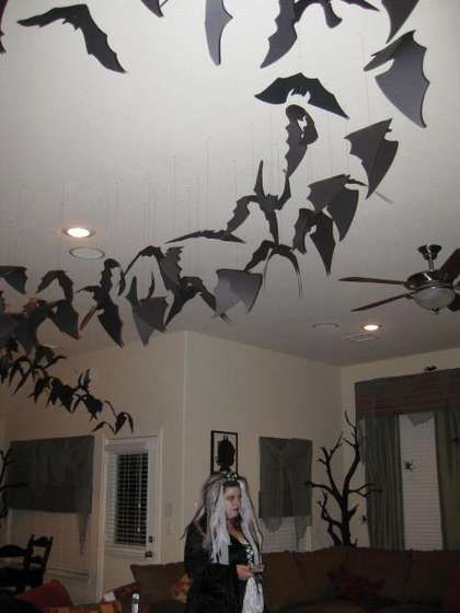 Flight of the Bats. Pinner said: (I have done this the past two years, and it always looks AMAZING.  This last year I sprayed GID spray on them, and added a black light to my hallway. The effect was beyond perfect!) <<< great idea!!!