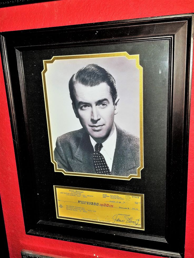 JIMMY STEWART AUTOGRAPH SIGNED CHECK DISPLAY - BANK CHECK SIGNED 1979