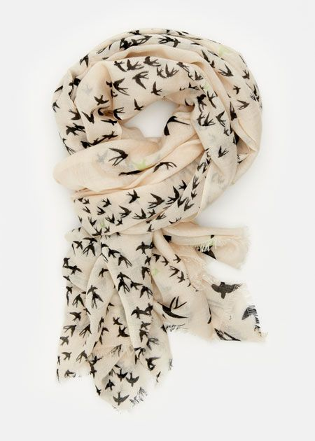 I've seen an infinity bird scarf on stitch fix Facebook posts that looks similar to this and I LOVE it. I would love it in white and black or a warm color like peach or pink.