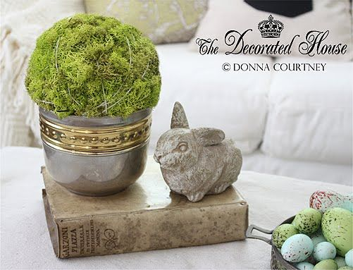 Spring - Easter decorating. Antique Italian Vellum Book, with moss ball in silver, & a garden style cement bunny. The Decorated House blog.