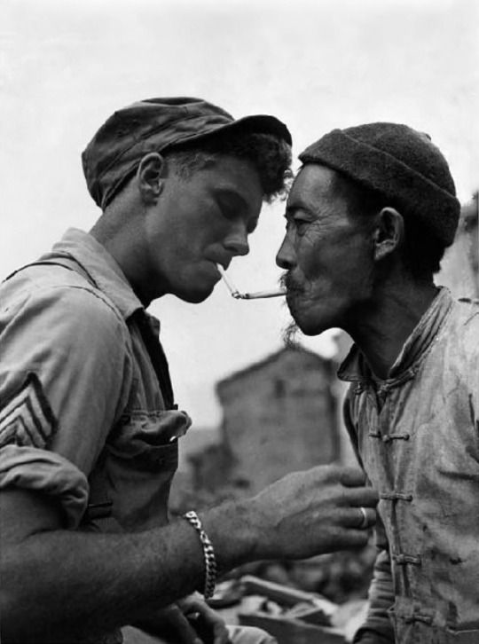 A U.S. Army Sgt. stops to request a light for his cigarette from an elderly Chinese man in the ruins of Tengchong. When the Japanese invaded Burma in January 1942, the Chinese Expeditionary Force (Y Force) led by General Wei Lihuang, along with the other Allied troops, were forced to retreat back along their lines of communications. Most of the Chinese soldiers retreated back into China. Beginning his offensive into southern Yunnan on 11 May 1944, Wei's troops recaptured Tengchong from the…