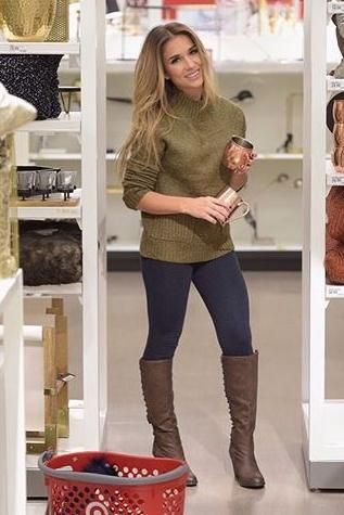 Jessie James Decker wearing Xhiliration Mockneck Pocket Crop Sweater in Olive, Mossimo Aleeah Lace-Up Back Detail Boots and Merona Leggings