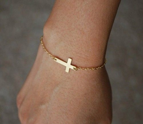 gold cross bracelet. @Lauren Ricca this matches your necklace!