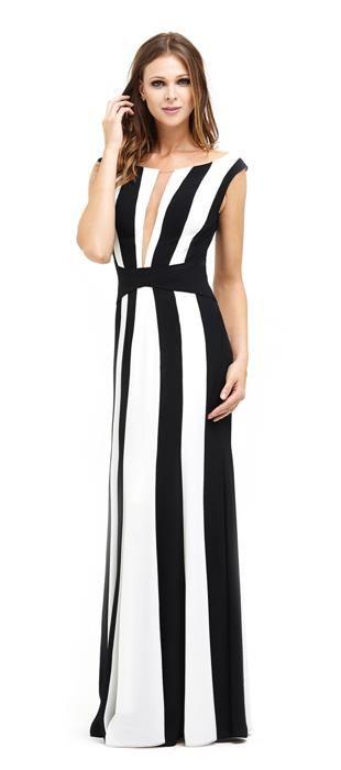 0fb15ad128 Vestido longo de crepe preto e branco. Os recortes na vertical em preto e  branco ajudam a alongar a silhueta e com o cinto preto