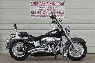 "$12,495 with 10,014 miles  This 2008 Softail Deluxe comes with Vance & Hines exhaust, K & N air filter, flame timing cover, flame air cleaner insert, flame derby cover, 12"" ape-hangers with internal wiring, front & rear floating brake rotors and a custom front fender skirt.  http://www.americanbikes4you.com/vehicle/4919820/2008-harley-davidson-softail-deluxe-flstn-wichita-kansas-67207"