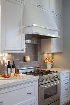 wrong tile but the idea is here shelf on top of stainless backsplash combined with shelf in wall alcove above range kitchen and baths traditional