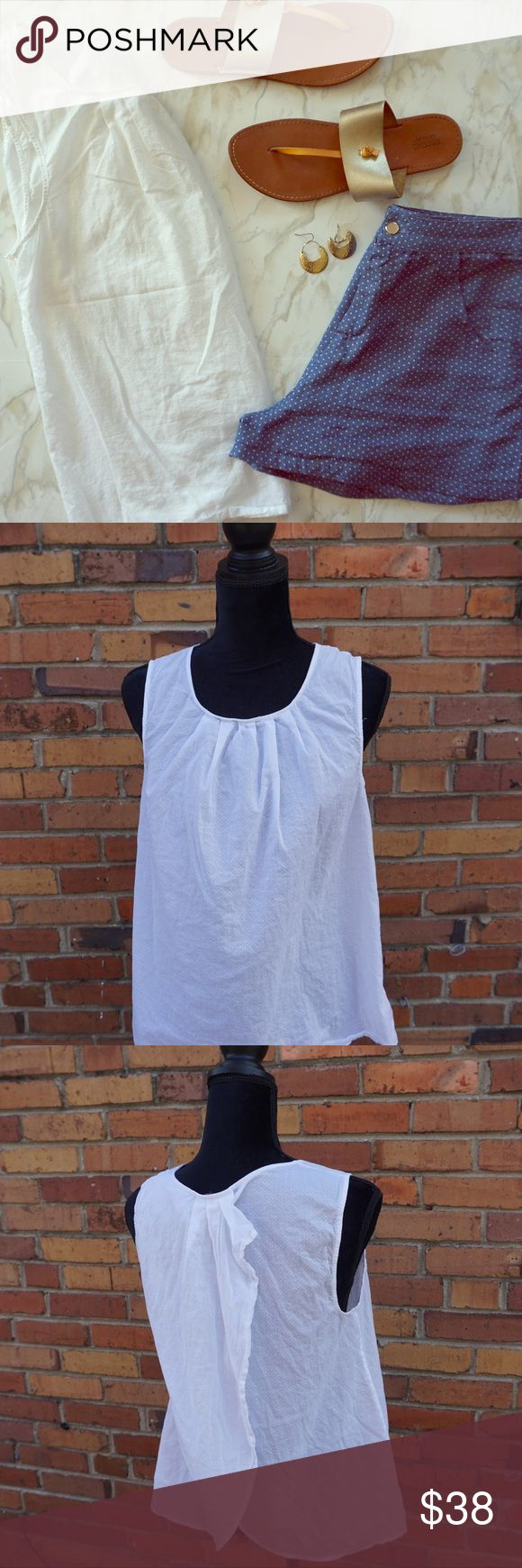 *HP* Anthropologie White Tulip Back Swiss Dot Tank Nothing says summer like a white tank top and this one is the perfect addition to your closet.  The tulip back is fun and flirty and the subtle white on white pools fit fabric makes the it unique.  The fabric is light so you'll stay cool outside.  I love the wider straps because it means I can wear a regular bra and the straps won't show. In excellent condition with no tears or stains. Anthropologie Tops Tank Tops
