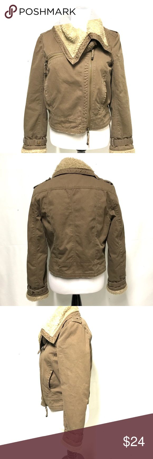 French connection bomber style jacket French connection bomber jacket in canvas like shell and faux shearling lining. VERY WARM!! I zipper closure just left of center front. Overall exterior is in very good pre-owed condition. French Connection Jackets & Coats