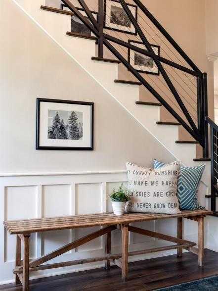 Joanna+considered+the+foyer+one+of+the+most+challenging+parts+of+this+makeover.+She+wanted+to+make+a+visual+statement+upon+entering+the+home+that+showcased+the+melding+of+both+rustic+and+traditional+elements.+A+simple+chair+railing+was+added+to+add+depth+and+texture+to+the+space,+but+without+too+much+formality.+The+new+iron+railing+with+contemporary+cabled+design+is+a+counterbalancing+element+and+a+statement+piece+in+a+room+that+sets+the+tone+for+the+home's+carefully+integrated+design.