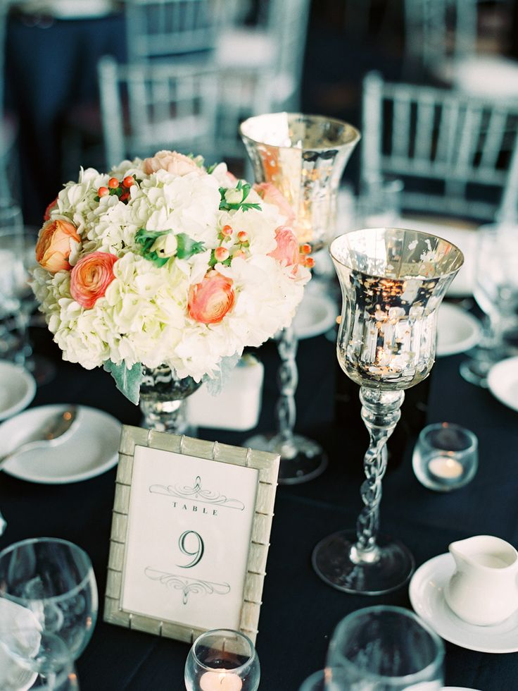 White and coral centerpiece arrangement in a compote with