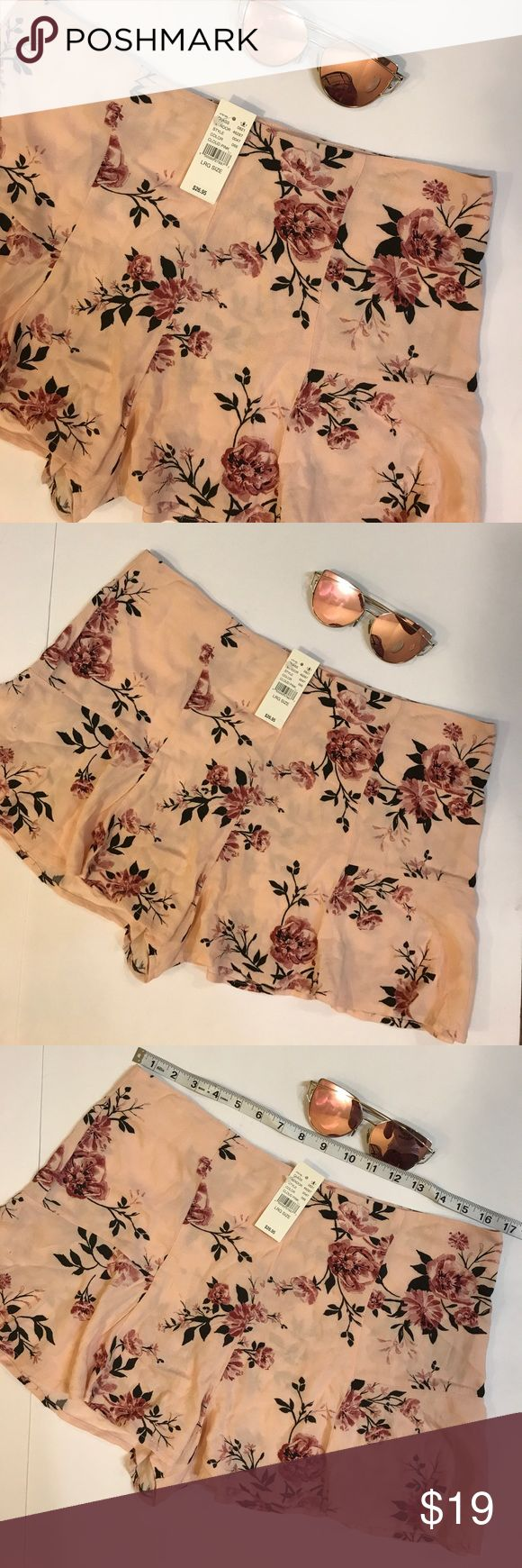 NWT Kendall & Kylie Pink Floral Print Shorts Brand New with Tags Kendall & Kylie Shorts. Measurements are pictured. These shorts are 100% rayon and have a zipper on the back Kendall & Kylie Shorts