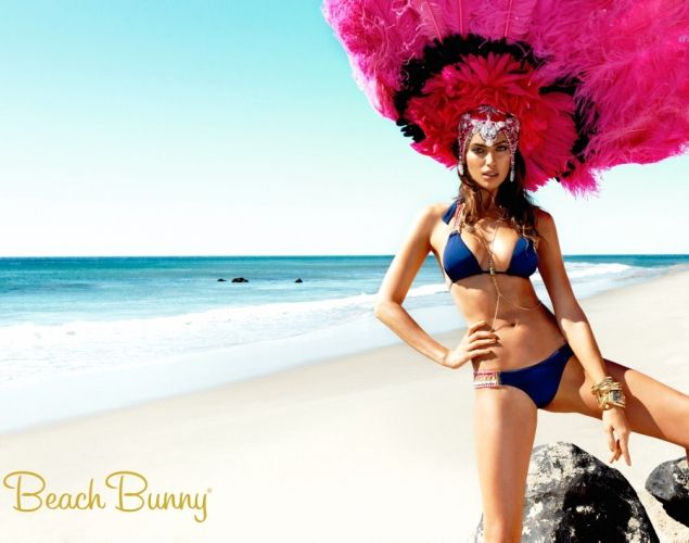Irina Shayk models bikinis for Beach Bunny Swimwear's Take Me to Rio campaign.