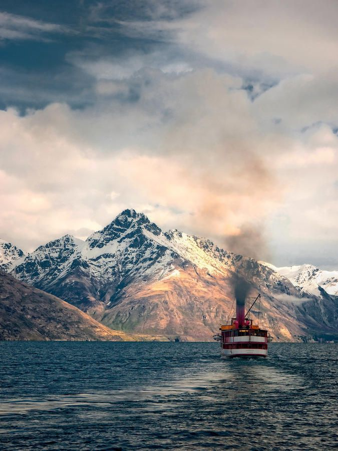 The TSS Earnslaw heading out to Walter Peak High Country Farm, book with Real Journeys  - https://www.realjourneys.co.nz/en/experiences/cruises/tss-earnslaw-vintage-steamship-cruises/