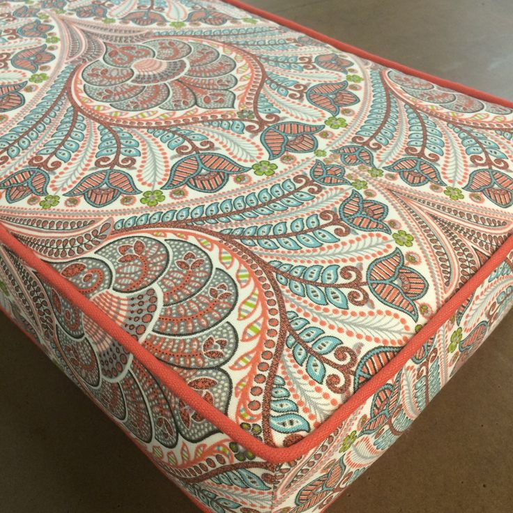 Agorgeous paisley meets-peacock-plume fabric in a coral and clay grey combo with a hit of acid lime green and aqua blue and cream. This fabric issuitable for
