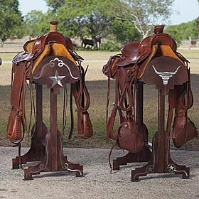 "LONGHORN IRON SADDLE STAND  Display your prized or working saddle on this rugged saddle stand. Saddles won't slip off the heavy duty steel frame that's accented with a rugged copper and silver finish and a prominent rope and Longhorn motif on each end. 4-6 weeks delivery. 20""w x 27 1/2 ""d x 39 1/2""h.  krsaddleshop.com"