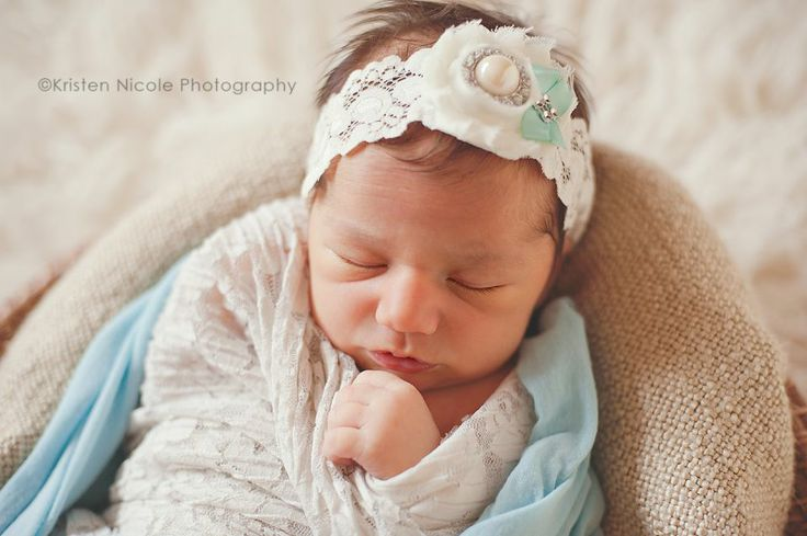 Used her Mother's wedding garter as a headband!