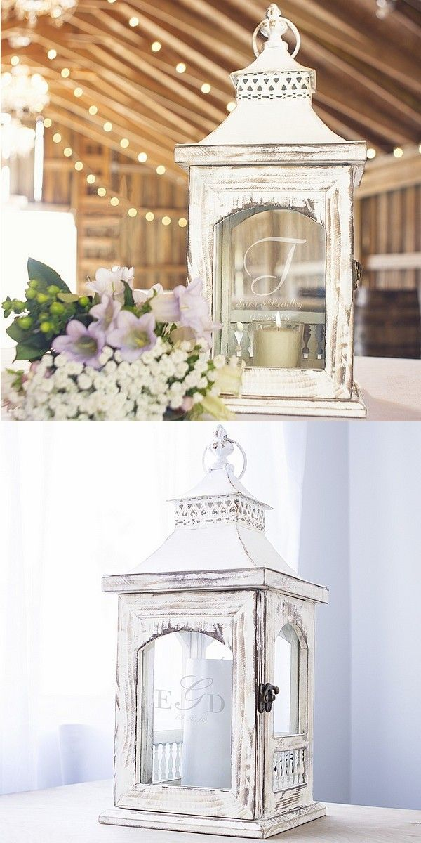 A unique and elegant centerpiece to illuminate the reception bridal table and guest tables, this rustic whitewash finish wood lantern with metal top and glass sides is laser engraved with a single initial and two lines of custom print or a 3-letter monogram and wedding date. The 7 inch square frame towers 18 inches tall for an impressive focal point for wedding table centerpieces. This lantern can be ordered at…