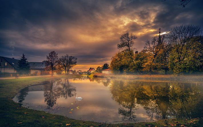 Download wallpapers autumn, lake, village, white swan, sunset
