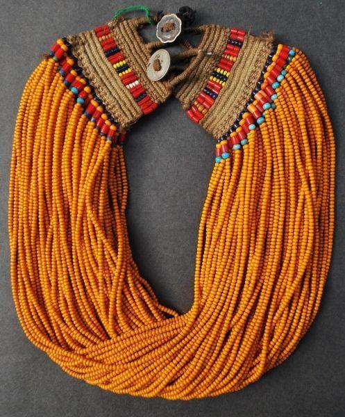 orange beaded necklace (poeticeyess)
