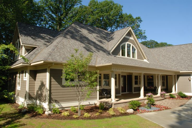 Hardie board colors exterior traditional with front doors arched windows cement board front porch side load garage water feature james hardie