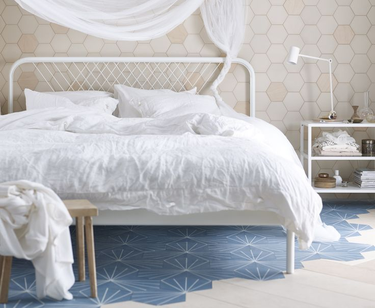 Bring a new look to the bedroom with the white NESTTUN bed featuring a unique headboard that can be personalised.