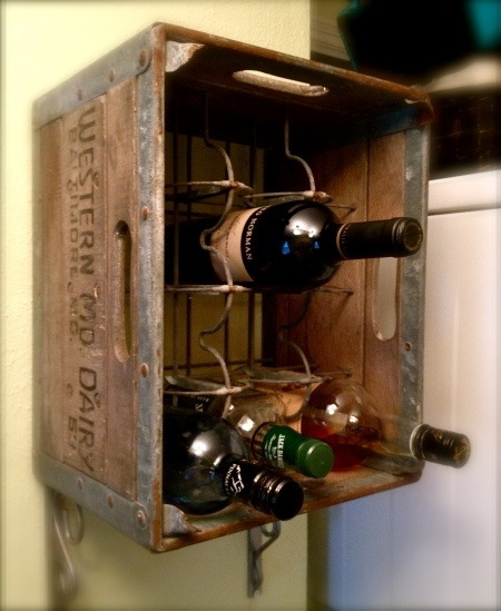 Old milk crate turned wine rack.