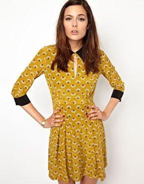 Orla Kiely Collar Detail Dress in Posey Print Silk  Made from 100% silk -	Contrast collar and cuffs -	Peekaboo cut-out detail to front -	Posey print design -	Self-tie to waist -	Concealed zip closure to back -	Soft pleats to skirt -	Regular fit