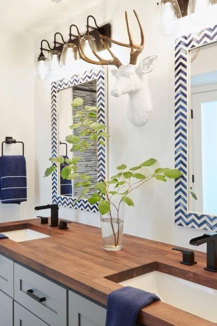 Blue chevron mirrors, white bathroom cabinets and butcher block counter   Entertaining Spaces From HGTV Dream Home 2018   HGTV Dream Home 2018   HGTV