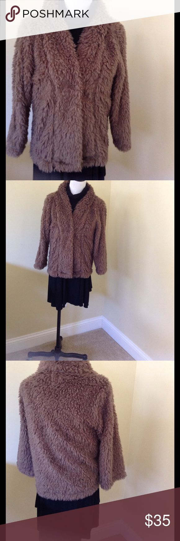 Dylan for True Grit Jacket Dylan for True Grit, shaggy jacket. Medium brown shaggy jacket with 3/4 sleeves and single snap closure. EUC, does have some of the shaggy fabric coming through inside liner. True Grit Jackets & Coats