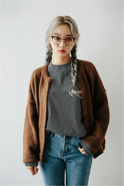 Minimal casual, high-rise jeans, brown large cardigan, grey shirt, with round glasses and silver hair