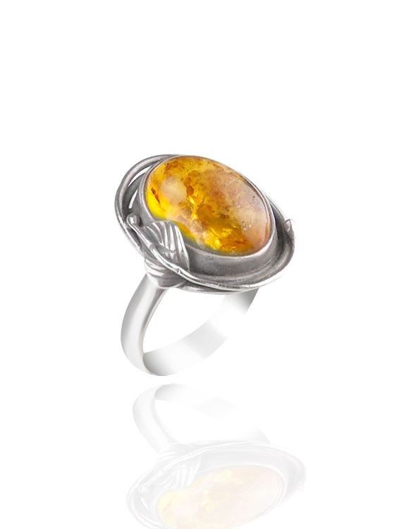 Antique style oxidised Silver and honey Amber ring featuring ornate leaf design on one edge. onyxgoldsmiths.co.uk #jewellery #ring #summer #amber
