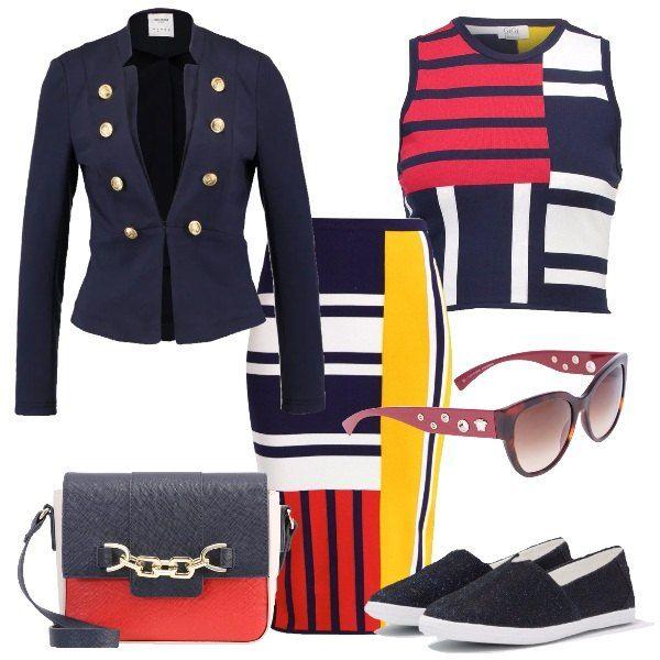 Outfit geometrico, colorato e comodo grazie alle sneakers in tessuto brillante blu. Un completo formato da una gonna a tubino aderente a vita altissima dalla stampa geometrica e colorata di blu, bianco, rosso e giallo, il top è con la stessa stampa e rimane corto mentre il blazer è blu con 8 bottoni dorati anteriori. Per completare il look, una tracolla in blu, bianco e rosso con catenina dorata e un paio di occhiali da sole con borchie sulle asticelle.