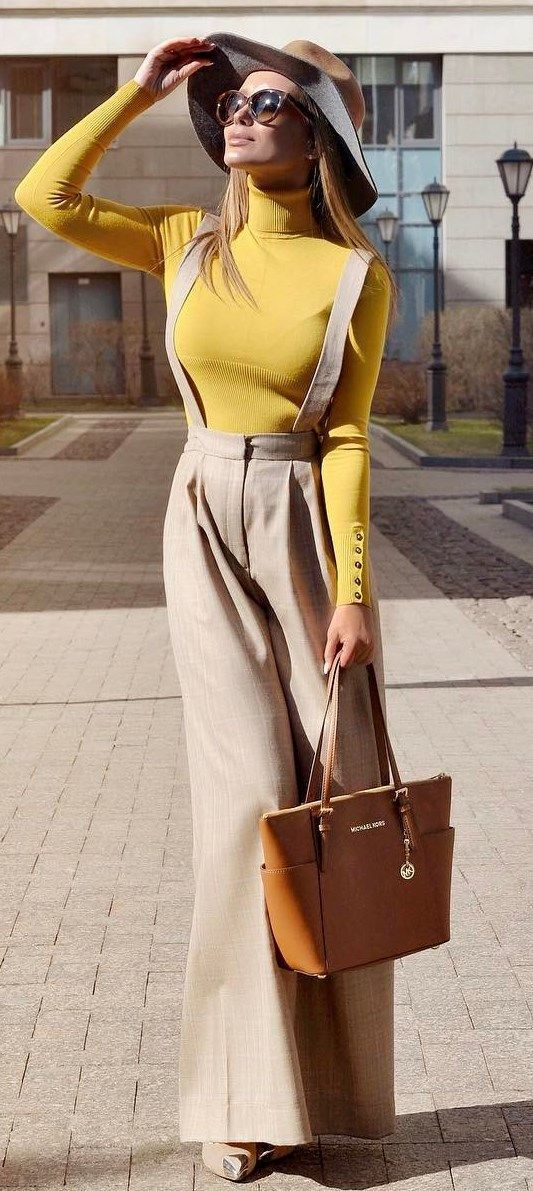 467f6a05d5eab Beautiful Fall Outfit Idea Hat Plus Nude Jumpsuit Plus Yellow Top Plus Bag