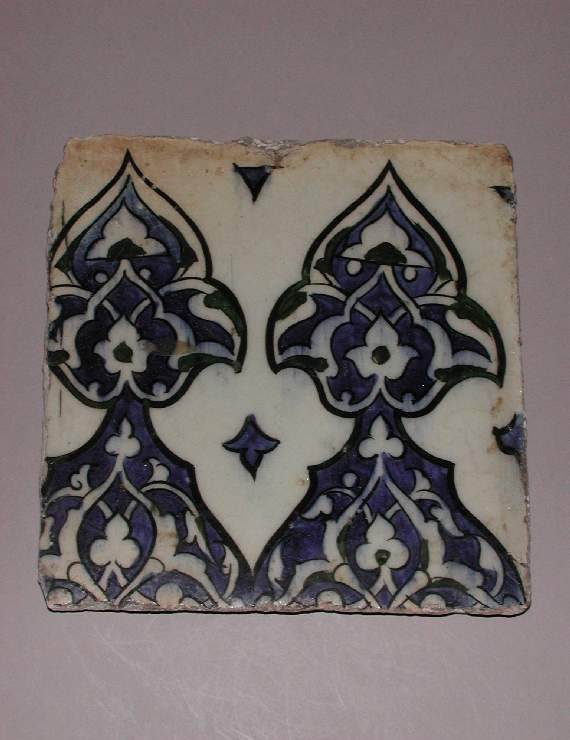 Maker: Unknown; potter Category: fritware (stonepaste) Name(s): tile Islamic pottery; category Iznik; category Other Name: Border tile, part of tile panel (C.4-1928) Date: 1574 — 1599 School/Style: Ottoman Period: late 16th Century