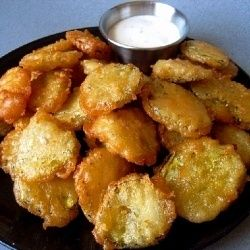 Dill Pickle Chips drained, 3/4 to 1 cup of beer, 2 eggs, 1 -2 cups of flour, mix and dip pickles and fry until golden brown. Dip in Ranch dressing.