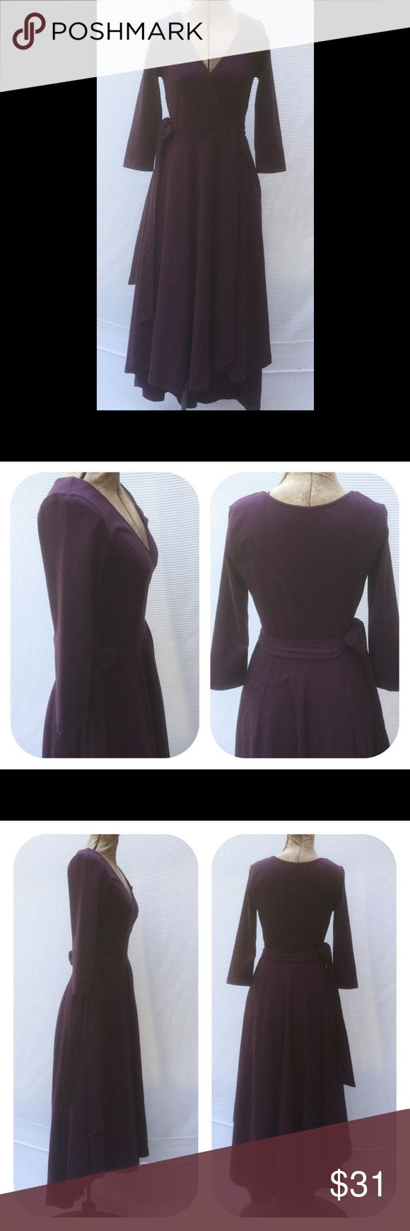 "New Eshakti Purple Knit Fit Flare Wrap Dress XS 2 New Eshakti purple knit fit & flare midi wrap dress Size 2 Measured flat: Underarm to underarm: 30"" Waist: 26""+ Length: 41"" & 51 ½"" Sleeve: 17""  Eshakti size guide for 2 bust: 33"" True wrap styling, wide surplice v neck, cross over skirt. Bracelet length sleeves, attached half ties at seamed waist, side seam pockets, high low hem. Cotton/spandex, woven jersey knit, light stretch. Machine wash. New w/ cut out Eshakti tag to prevent returning…"