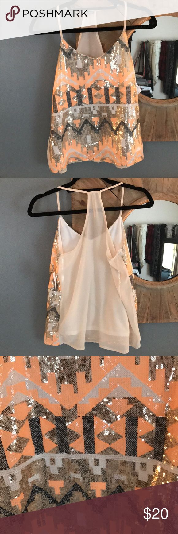 Aztec sequined tank top NWT Charlotte Russe sequined tank top. Women's size S. Polyester. Stunning Aztec print in black, gold, white and peach. Racer Back and also the back is completely sheer. Charlotte Russe Tops Tank Tops