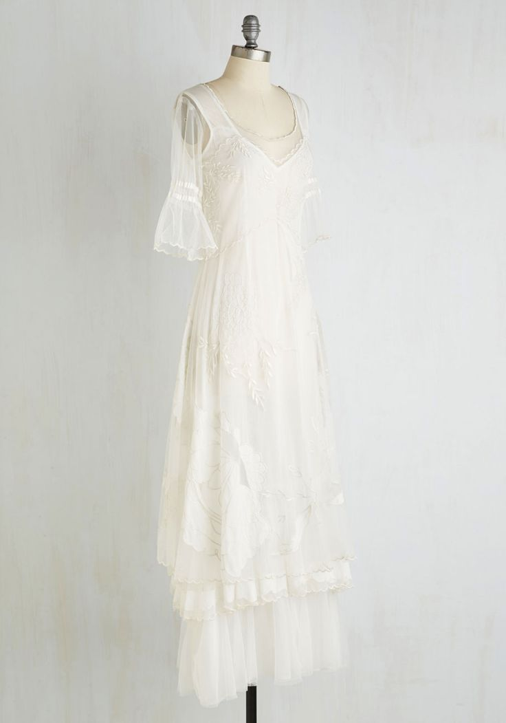 For an enchanted occasion such as this, you entrance onlookers with your white dress. Its sheer, embroidered overlay blossoms with delight, while a slight flare to its half sleeves, a tiered hemline, and a light, woven slip lining are the definition of ethereal.