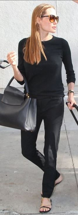 Who made Angelina Jolie's gold chain flat sandals, black pants, black leather handbag, and brown sunglasses that she wore at LAX airport on August 15, 2013?