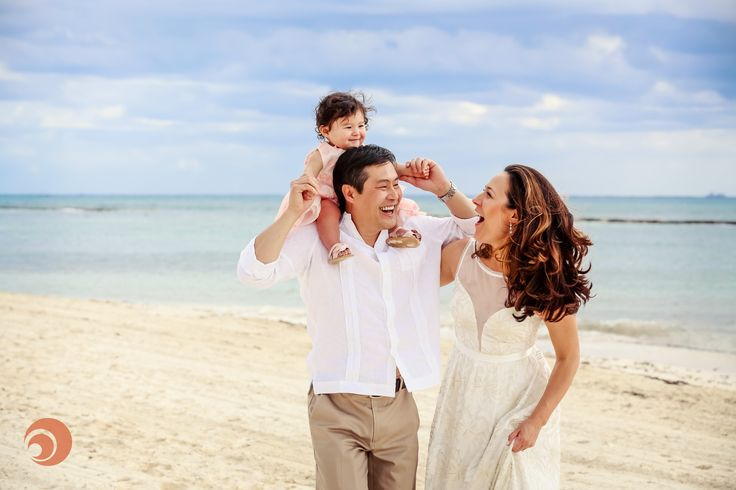A family share laughs during s family photo session by #DreamArtPhotography at @gvrivieramaya, Mexico.