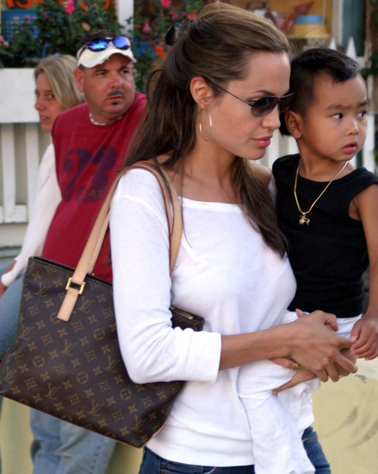 The Many Bags of Angelina Jolie-HUMPhooks will provide a convenience to her handbags as she tends to baby!