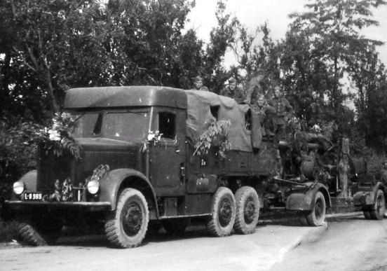 Slovak army in the year 1944. Military truck Skoda 6ST6-L (6x4, load 4t, Otto-engine, 6 cylinders with a 8.2 l, 100) and feared Flak 88. The...