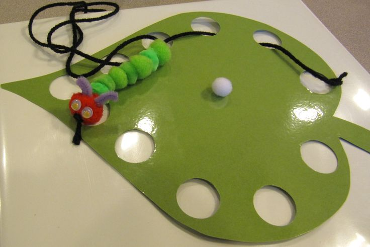 Very Hungry Caterpillar - Great art project and fine motor for kiddos. They cut out their leaves, I laminated them and used a giant hole punch for the holes. The students chose what colors for their caterpillar. Older students could lace their own pom poms, but for the preschoolers I laced them for them. Then they made the caterpillar eat the leaf. The white pom pom is the tiny egg that the caterpillar hatched from. For more ideas visit me on Facebook at - Adventures in Tutoring